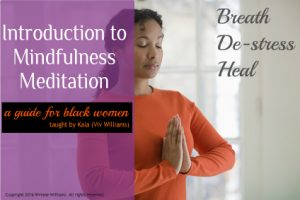 Black woman in meditative prayer pose palms together